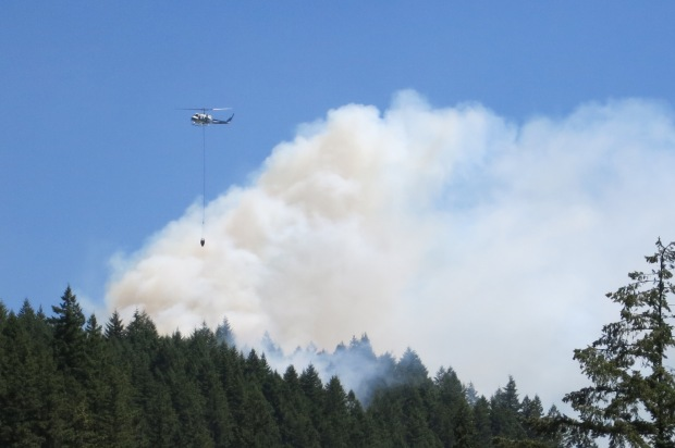 Forest Service helicopter dropping water on Mt. Si fire